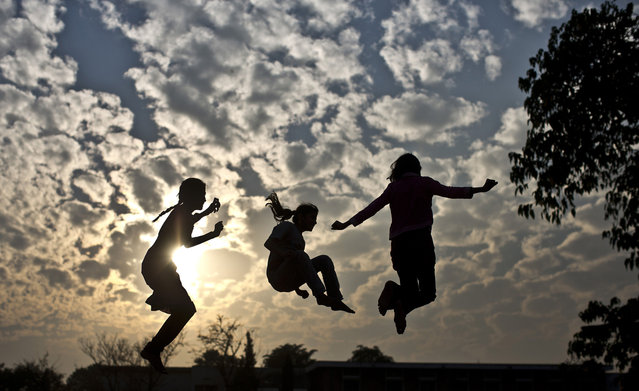 Pakistani girls enjoy jumping on a trampoline after paying for the owner each 10 Rupees (U.S. 16 cents) per ten minutes in a Christian neighborhood in Islamabad, Pakistan, Wednesday, November 27, 2013. (Photo by Muhammed Muheisen/AP Photo)