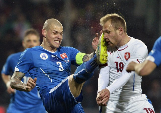 Martin Skrtel (L) of Slovakia catches Daniel Kolar of Czech Republic in the face during the friendly international football match between Slovakia and Czech Republic at Stadion Pod Dubnom in Zilina, Slovakia on March 31, 2015. (Photo by Radovan Stoklasa/AFP Photo)