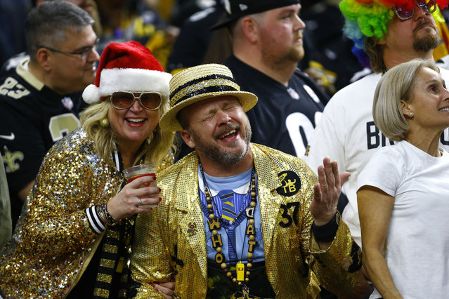 New Orleans Saints fans celebrates in the second half of an NFL football game against the Pittsburgh Steelers in New Orleans, Sunday, December 23, 2018. The Saints won 31-28, clinching the top seed for the NFC and home field advantage for the playoffs. (Photo by Butch Dill/AP Photo)
