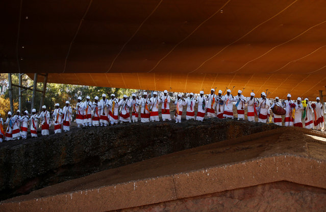 Ethiopian Orthodox choir members perform during Ethiopian Christmas celebration in Bete Maryam (House of Mary) monolithic church during Ethiopian Christmas celebration in Lalibela, Ethiopia, January 7, 2017. (Photo by Tiksa Negeri/Reuters)