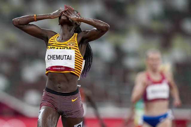Peruth Chemutai, of Uganda, celebrates after winning the women's 3,000-meter steeplechase final at the 2020 Summer Olympics, Wednesday, August 4, 2021, in Tokyo. (Photo by Petr David Josek/AP Photo)