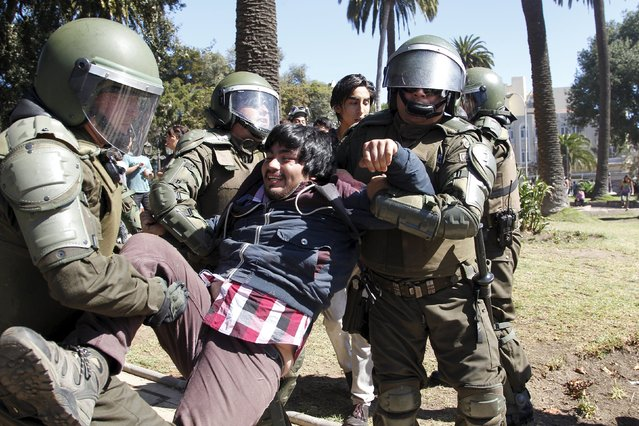 A student is detained by riot police during a protest against the government to demand changes and end to the profiteering in the education system in Valparaiso,  April 16, 2015. (Photo by Rodrigo Garrido/Reuters)