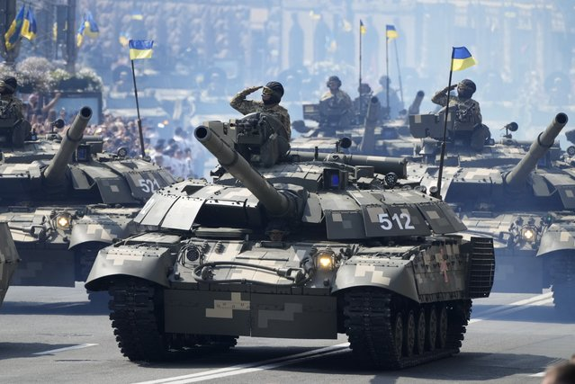 Tanks ride along Khreshchatyk Street, during a military parade to celebrate Independence Day in Kiev, Ukraine, Tuesday, August 24, 2021. (Photo by Efrem Lukatsky/AP Photo)