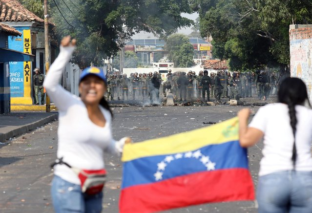 Security forces take position while clashing with demonstrators in Urena, Venezuela, February 23, 2019. A truck loaded with humanitarian aid was set ablaze on Saturday on the Colombia-Venezuela border, an opposition deputy told reporters amid rioting on the Santander bridge crossing. (Photo by Andres Martinez Casares/Reuters)