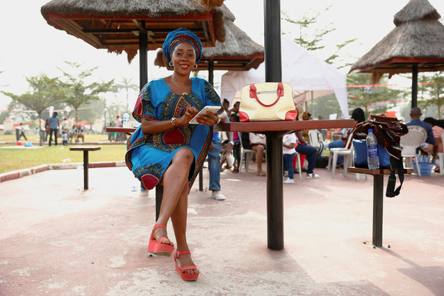 Picnicker Olawumi Akinkunmi poses for a photograph at an amusement park on Boxing Day in Ikeja district in Nigeria's commercial capital Lagos, December 26, 2016. (Photo by Aintunde Akinleye/Reuters)