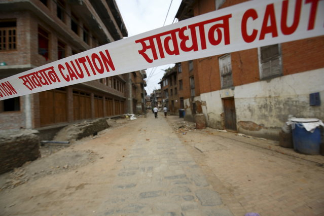 Precaution tape is seen on the streets of Bhaktapur a day after an earthquake in Bhaktapur, Nepal April 26, 2015. (Photo by Navesh Chitrakar/Reuters)