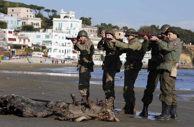 Volunteers wearing the uniform of the U.S. army pose as they participate in the re-enactment of a World War Two landing to mark its 70th anniversary in Anzio, near Rome, January 25, 2014. (Photo by Stefano Rellandini/Reuters)