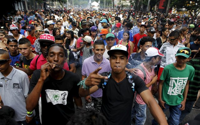 Protesters smoke marijuana during a demonstration in support of the legalization of marijuana in Medellin, May 2, 2015. (Photo by Fredy Builes/Reuters)