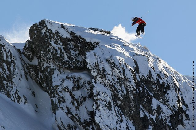 Freeskier Boen Ferguson launches off a drop during the World Heli Challenge freestyle day in backcountry at Minaret Station on July 31, 2011 in Wanaka, New Zealand