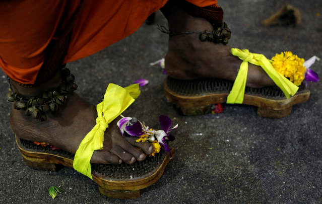 A devotee walks in clogs of nails during the Hindu festival of Thaipusam in Singapore February 9, 2017. (Photo by Edgar Su/Reuters)