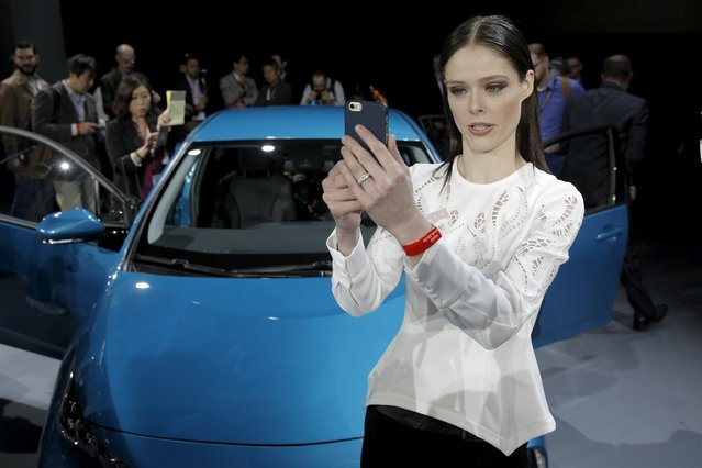 A woman takes a selfie in front of the Toyota Prius Prime during the media preview of the 2016 New York International Auto Show in Manhattan, New York March 23, 2016. (Photo by Brendan McDermid/Reuters)