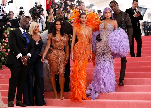 "Corey Gamble, Kris Jenner, Kanye West, Kim Kardashian, Kendall Jenner, Kylie Jenner and Travis Scott attend the 2019 Met Gala celebrating ""Camp: Notes on Fashion"" at the Metropolitan Museum of Art on May 06, 2019 in New York City. (Photo by Andrew Kelly/Reuters)"