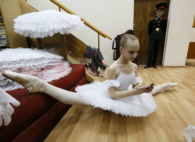 A student of the Krasnoyarsk choreographic college prepares backstage before a dress rehearsal of a performance by graduates of the college at the State Theatre of Opera and Ballet in Russia's Siberian city of Krasnoyarsk, Russia, May 12, 2015. The annual performance showcases the work of students from across Russia who study or have studied at the well-known school. (Photo by Ilya Naymushin/Reuters)