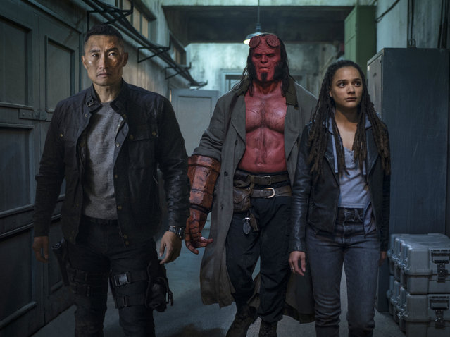 "This image released by Lionsgate shows, from left, Daniel Dae Kim, David Harbour and Sasha Lane in a scene from ""Hellboy"". (Photo by Mark Rogers/Lionsgate via AP Photo)"