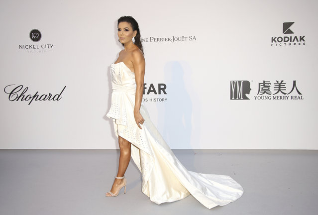 Actress Eva Longoria poses for photographers upon arrival at the amfAR, Cinema Against AIDS, benefit at the Hotel du Cap-Eden-Roc, during the 72nd international Cannes film festival, in Cap d'Antibes, southern France, Thursday, May 23, 2019. (Photo by Joel C. Ryan/Invision/AP Photo)
