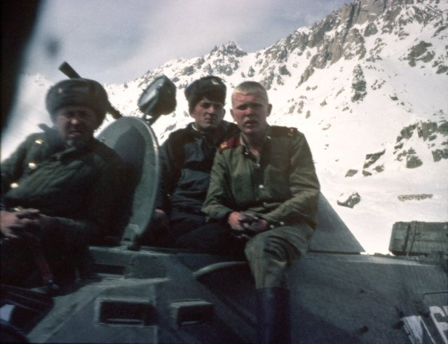 Russian soldiers sitting on a tank in the Hindu Kush mountains during the invasion of Afghanistan by the Russians, January 1980. They are on the road between Mazar-i-Sharif and Russia. (Photo by Romano Cagnoni/Getty Images)