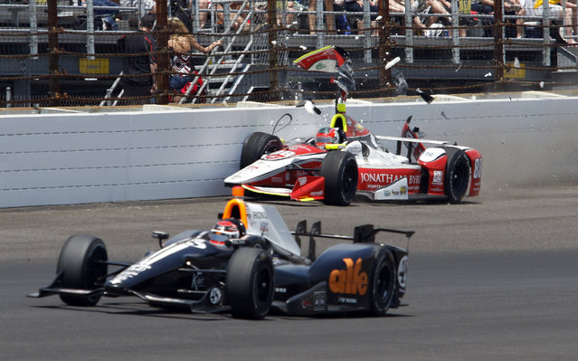 Alex Tagliani, of Canada, bottom, drives under Bryan Clauson hitting the wall in the fourth turn during the 99th running of the Indianapolis 500 auto race at Indianapolis Motor Speedway in Indianapolis, Sunday, May 24, 2015.  (Photo by Kirk Stierwalt/AP Photo)