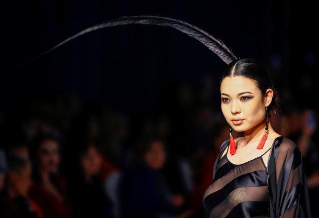 A model presents a creation by Kazakhstan's design house Khafiz Khan during Kazakhstan Fashion Week in Almaty, Kazakhstan, April 21, 2016. (Photo by Shamil Zhumatov/Reuters)
