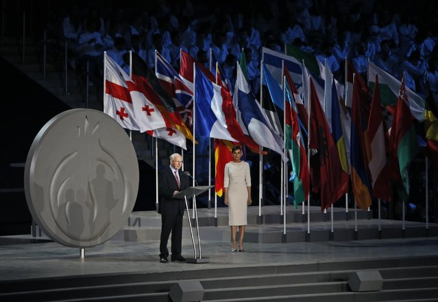 Patrick Hickey, the head of the European Olympic Committee, left, speaks during the opening ceremony of the 2015 European Games in Baku, Azerbaijan, Friday, June 12, 2015. Azerbaijani President Ilham Aliyev's wife is at the left. (AP Photo/Dmitry Lovetsky)