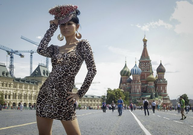 Actress Bai Ling poses for a picture in front of St. Basil's Cathedral at the Red Square in Moscow, Russia, July 1, 2015. (Photo by Ivan Burnyashev/Reuters)