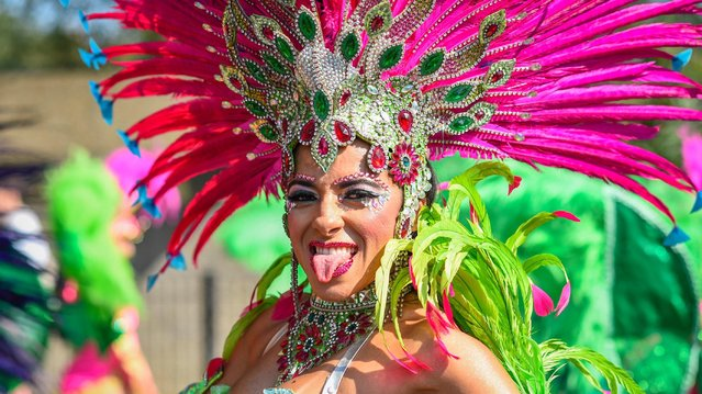 Revellers dance on the second and final day of the 2019 Notting Hill Carnival in London, England, on August 26, 2019. Hundreds of thousands of people again thronged the streets of the carnival, for what is billed as the main day of the event, this year partying in scorching conditions. (Photo by Stephen Chung/Alamy Stock Photos)
