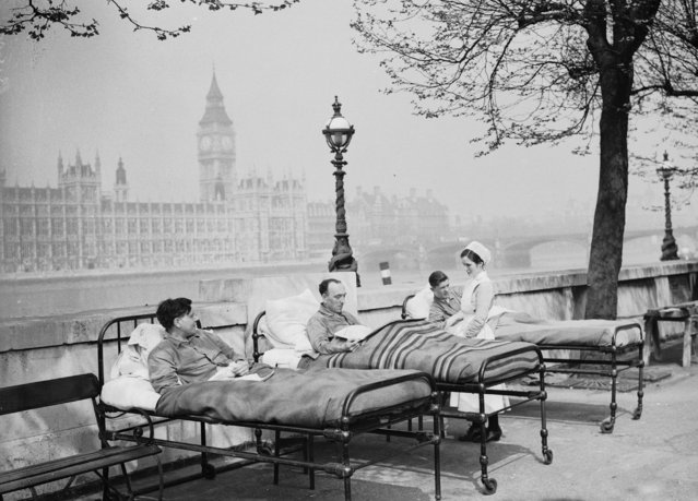 Tuberculosis patients from St. Thomas' Hospital rest in their beds in the open air by the River Thames, opposite the Houses of Parliament. May 1936. (Photo by Fox Photos/Getty Images)