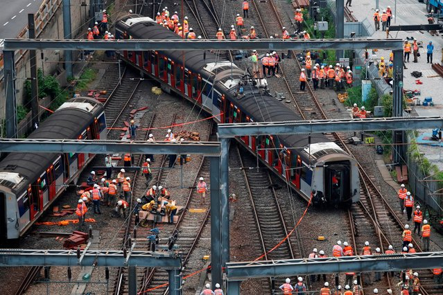 A Mass Transit Railway (MTR) train is seen derailed on the East Rail line in Hong Kong, China on September 17, 2019. (Photo by Tyrone Siu/Reuters)