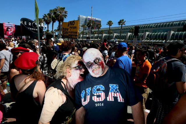 Sharon McLachlan and Richard DeWalt show their zombie costumes in The Gaslamp Quarter at the 2015 Comic-Con International in San Diego, California July 10, 2015. (Photo by Sandy Huffaker/Reuters)