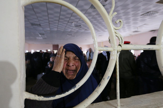 A Palestinian woman reacts as she asks for a travel permit to cross into Egypt through the Rafah border crossing, after it was opened by Egyptian authorities for humanitarian cases, in Rafah in the southern Gaza Strip February 12, 2017. (Photo by Ibraheem Abu Mustafa/Reuters)