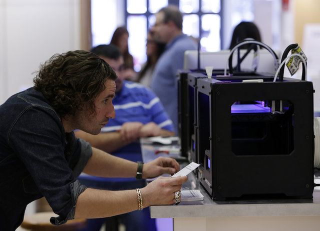 MakerBot Replicator 2 desktop 3D printers are calibrated at the GE Garage in Washington March 20, 2014. GE Garage space is open from March 24 to April 9 in Washington and offers the chance to explore and learn about how technology is changing the way things are built today. (Photo by Gary Cameron/Reuters)