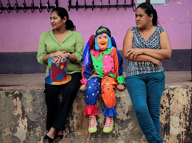 A child dressed as a clown takes part in the celebration of the Virgen de los Desamparados, or Our Lady of the Abandoned, at Diria town, Nicaragua May 14, 2016. (Photo by Oswaldo Rivas/Reuters)
