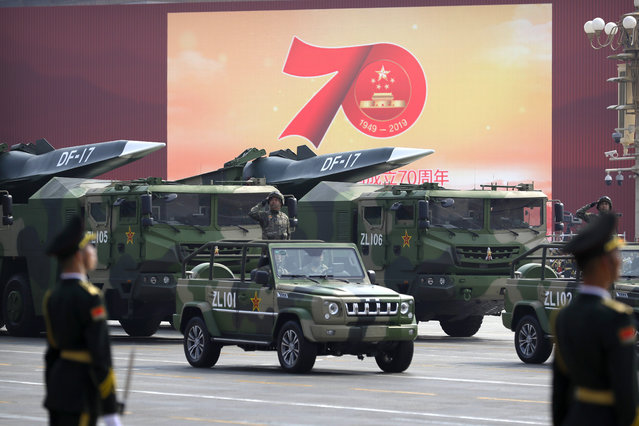 Chinese military vehicles carrying DF-17 ballistic missiles roll during a parade to commemorate the 70th anniversary of the founding of Communist China in Beijing, Tuesday, October 1, 2019. (Photo by Mark Schiefelbein/AP Photo)