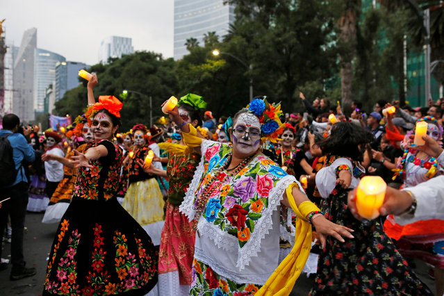 eople dressed as Catrinas parade down Mexico City's iconic Reforma avenue during celebrations for the Day of the Dead in Mexico, City, Saturday, October 26, 2019. (Photo by Ginnette Riquelme/AP Photo)