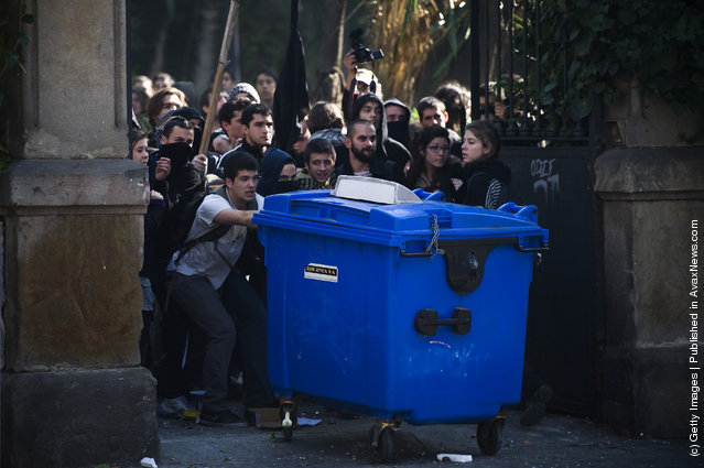 Students set up a barricade during a demonstration on February 29, 2012 in Barcelona