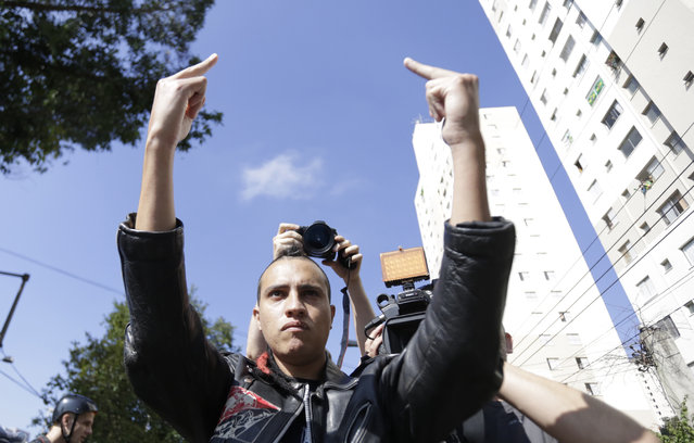 A demontrator shouts at riot policemem during a protest against the 2014 World Cup in Sao Paulo June 12, 2014. (Photo by Lunae Parracho/Reuters)