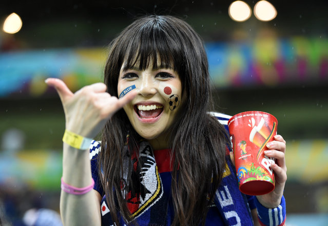 A Japanese supporter gestures as she waits for the start of the Group C football match between Ivory Coast and Japan at The Pernambuco Arena in Recife on June 14, 2014, during the 2014 FIFA World Cup. (Photo by Javier Soriano/AFP Photo)