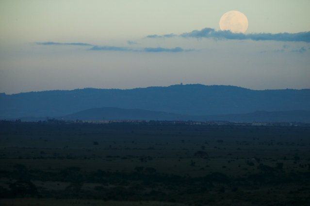 The moon rises over the Nairobi National Park as seen from the Impala Observation Point, as Secretary of State John Kerry visits, Sunday, May 3, 2015, in Nairobi, Kenya. (Photo by Andrew Harnik/Reuters)
