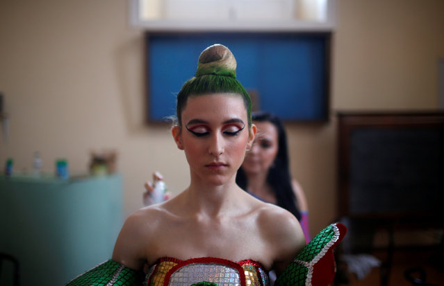 A member of Alfama's group gets ready before going to the Saint Anthony's Parade in Lisbon, Portugal June 12, 2016. (Photo by Rafael Marchante/Reuters)