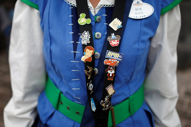 A member of staff shows her Disney badges at Shanghai Disney Resort during a three-day Grand Opening events in Shanghai, China, June 15, 2016. (Photo by Aly Song/Reuters)