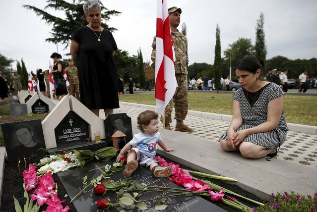 Relatives of the Georgian soldiers killed during Georgia's war conflict with Russia over the breakaway region of South Ossetia in 2008 mourn during a ceremony at the memorial cemetery in Tbilisi, Georgia, August 8, 2015. (Photo by David Mdzinarishvili/Reuters)
