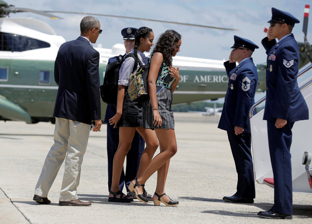 U.S. President Barack Obama watches as his daughters Malia and Sasha board Air Force One at Joint Base Andrews, Maryland, U.S., June 17, 2016. (Photo by Joshua Roberts/Reuters)