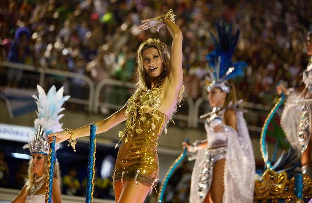 Brazilian model Gisele Bundchen dances on a Vila Isabel samba school float during carnival celebrations in the Sambadrome in Rio de Janeiro, Brazil, early Monday March 7, 2011