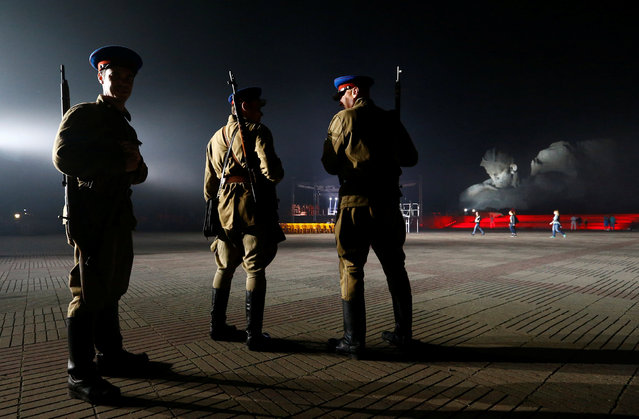 Military enthusiasts dressed as red army soldiers from period of World War two stand at the memorial at Hero fortress as they mark the 75th anniversary of the Nazi Germany invasion, in Brest, Belarus June 22, 2016. (Photo by Vasily Fedosenko/Reuters)