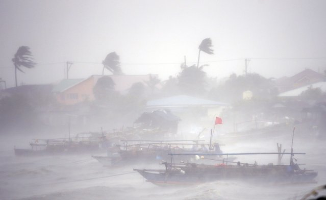 Fishing boats are pictured amid heavy winds and rain brought by Typhoon Rammasun (locally named Glenda) as it hit the town of Imus, Cavite southwest of Manila, July 16, 2014. (Photo by Erik De Castro/Reuters)