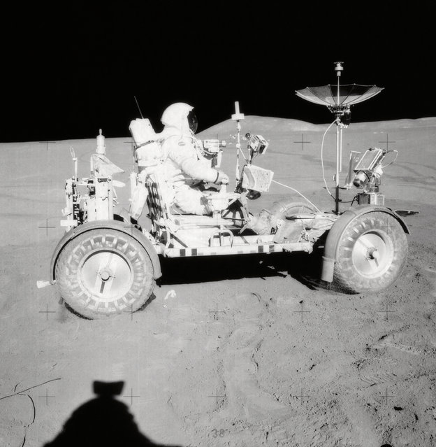 David R. Scott, Apollo 15 Commander, is seated in the Rover, Lunar Roving Vehicle (LRV) during the first lunar surface extravehicular activity (EVA-1) at the Hadley-Apennine landing site. (Photo by NASA)