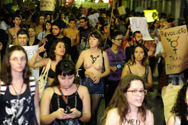 Feminists take part in the March of b*tches in downtown Florianópolis, Brazil on August 14, 2015. The motion calls for an end to gender violence and prejudice, defends body sexuality and reproductive life. (Photo by Eduardo Valente/Frame/Estadão Conteúdo)