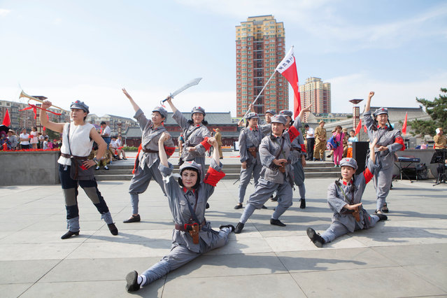 People perform a dance wearing army uniforms for the upcoming 95th anniversary of the foundation of Communist Party of China, in Changchun, Jilin Province, China June 16, 2016. (Photo by Reuters/Stringer)