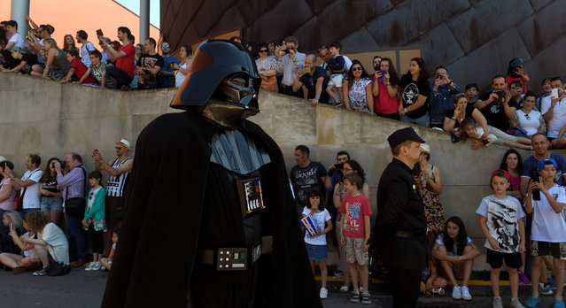 A cosplayer dressed as Darth Vader is seen during the parade in Metropoli (Media Culture and Entertainment Festival) in Gijon, northern Spain, July 3, 2016. (Photo by Eloy Alonso/Reuters)