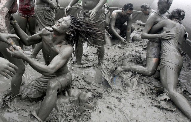 Tourists enjoy themselves at the 15th annual mud festival on Daecheon Beach in Boryeong, South Korea