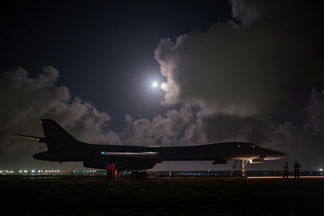 In this image released by the U.S, Air Force, a B-1B Lancer assigned to the 9th Expeditionary Bomb Squadron, deployed from Dyess Air Force Base, Texas, prepares for takeoff from Andersen AFB, Guam, to conduct a sequenced bilateral mission with South Korean F-15 and Koku Jieitai (Japan Air Self-Defense Force) F-2 fighter jets, July 7, 2017. (Photo by Airman 1st Class Jacob Skovo/U.S. Air Force via AP Photo)